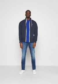 Tommy Jeans - SOLID TRACK JACKET - Zip-up hoodie - blue - 1