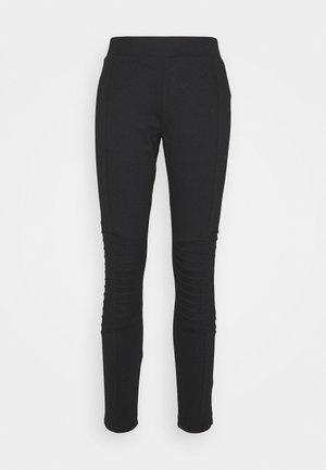 BIKER PANTS - Trousers - black