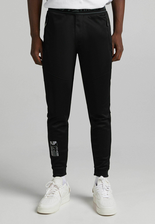 Herren SLIM FIT - Jogginghose - black