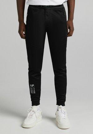 SLIM FIT - Pantaloni sportivi - black