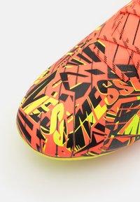 adidas Performance - NEMEZIZ MESSI .1 FG - Moulded stud football boots - solar red/solar yellow/core black - 5