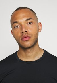 Björn Borg - ABER TEE - Sports shirt - black beauty - 3