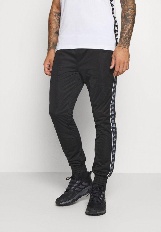 HELGE PANT - Pantaloni sportivi - caviar