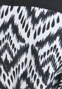 DORINA CURVES - GARISSA - Bikiniöverdel - black - 2