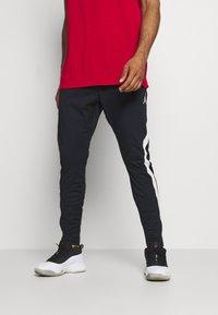 Jordan - AIR DRY PANT - Pantalones deportivos - black/white - 0