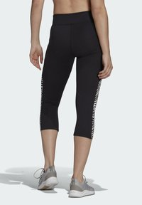 adidas Performance - U4U AEROREADY 3/4 LEGGINGS - 3/4 sports trousers - black - 1