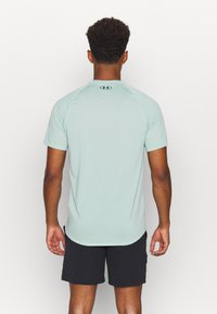 Under Armour - TECH NOVELTY - Basic T-shirt - enamel blue