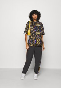 adidas Originals - PAOLINA RUSSO ADICOLOR SPORTS INSPIRED MID RISE PANTS - Pantalones deportivos - black - 1