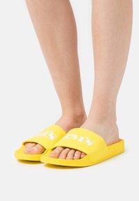 Levi's® - JUNE MONO  - Mules - regular yellow - 4