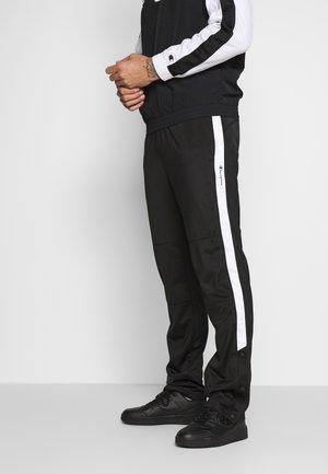 BREAKAWAY PANTS - Teplákové kalhoty - black