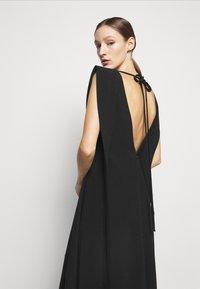 Victoria Beckham - DOUBLE FLARE MIDI - Cocktail dress / Party dress - black - 3