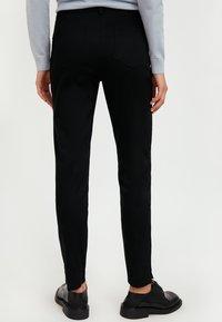 Finn Flare - Trousers - black - 2