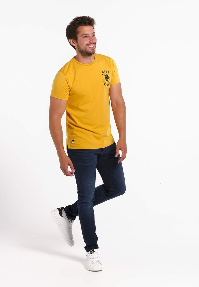 T-shirt print - geel