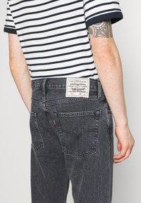Levi's® - WELLTHREAD 502™ - Straight leg jeans - black denim - 6