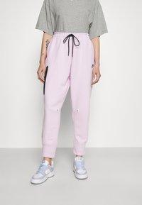 Nike Sportswear - Tracksuit bottoms - pink foam - 0