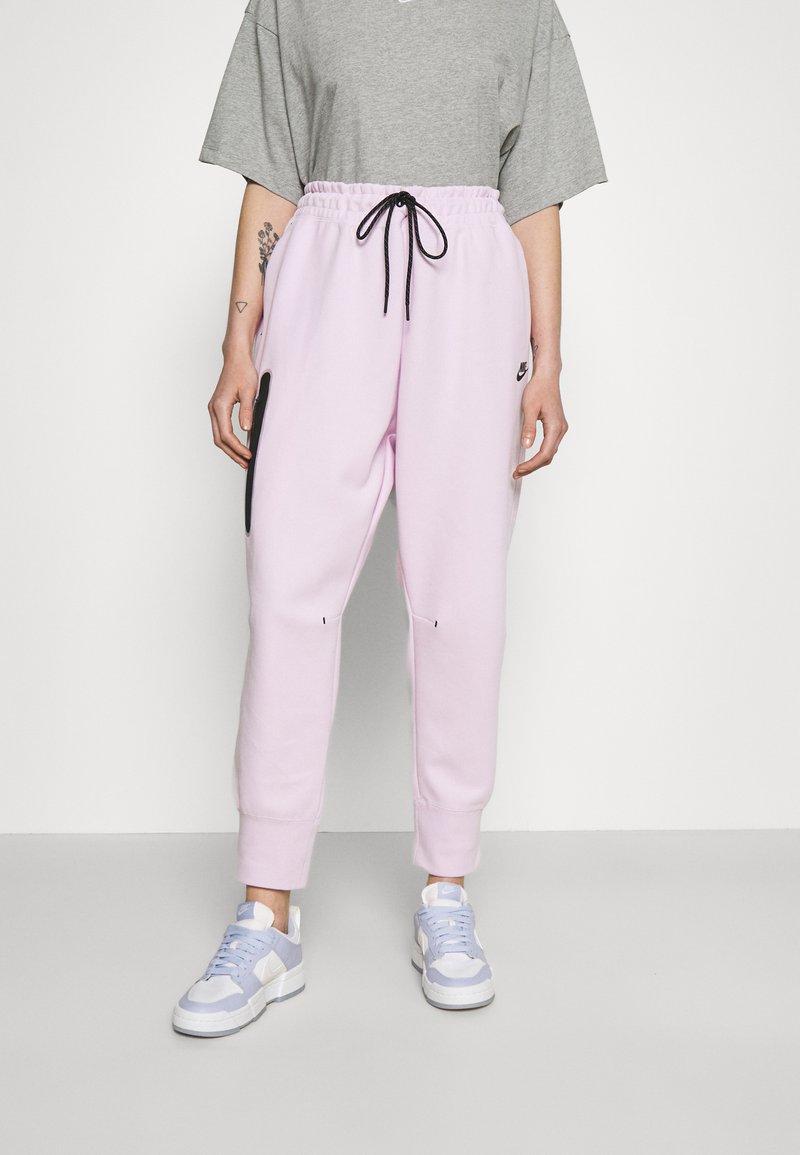 Nike Sportswear - Tracksuit bottoms - pink foam