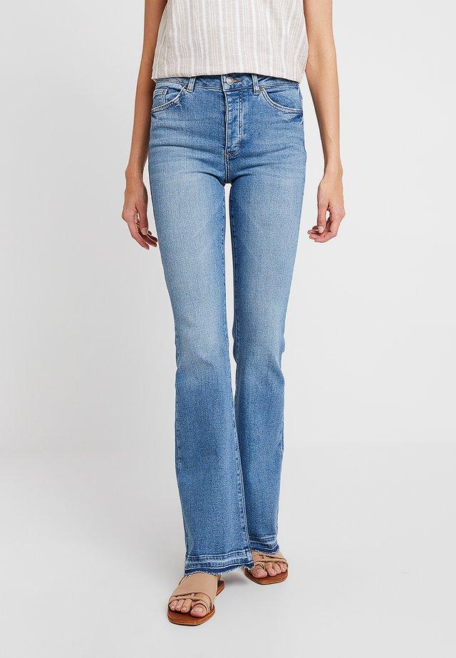 Jeans bootcut - destruct auto