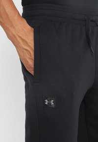Under Armour - RIVAL  JOGGER - Tracksuit bottoms - black - 4