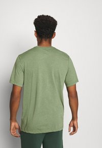 Nike Performance - DRY TEE YOGA - Basic T-shirt - galactic jade/oil green - 2