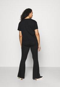 Calvin Klein Jeans Plus - PLUS KNOTTED TEE - Print T-shirt - black - 2
