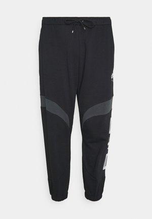 AIR - Tracksuit bottoms - black