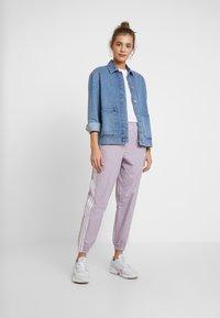 adidas Originals - LOCK UP ADICOLOR NYLON TRACK PANTS - Teplákové kalhoty - purple - 1