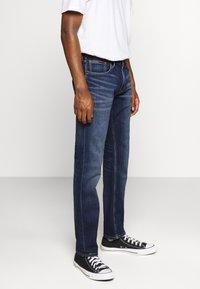 Tommy Jeans - RYAN STRAIGHT - Jeans straight leg - blue denim - 0