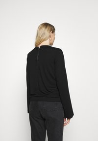 Marc O'Polo PURE - CREW NECK ZIPPER AND ASYMETRICAL HEMLINE - Langærmede T-shirts - pure black - 2