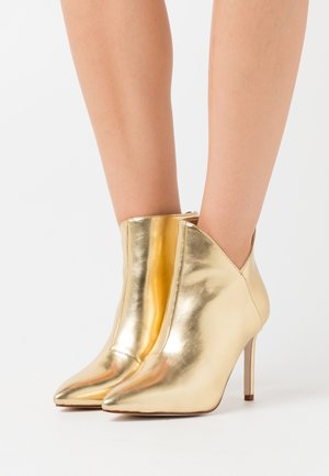 DIANNE - Bottines à talons hauts - gold