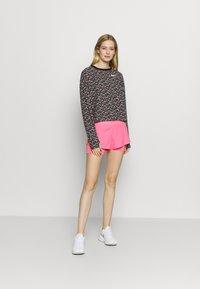 Nike Performance - ECLIPSE 2 IN 1 - kurze Sporthose - pink glow - 1