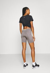 Nike Performance - FAST SHORT TRAIL - Leggings - enigma stone/silver - 2