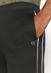 Calvin Klein Performance - PANT - Tracksuit bottoms - black/bright white - 5