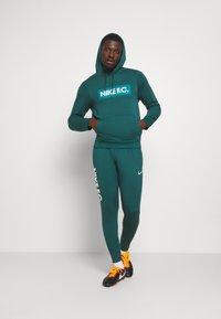 Nike Performance - FC  - Tracksuit bottoms - dark atomic teal/white/healing jade - 1