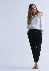 Cream - ANETT PANTS - Trousers - pitch black - 4