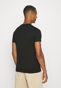 Calvin Klein Jeans - OFF PLACED ICONIC TEE UNISEX - T-shirt con stampa - black - 2