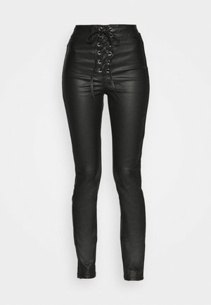 COATED CORSET DETAIL - Trousers - black