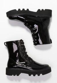 Calvin Klein Jeans - DIAHNE - Platform ankle boots - black - 3