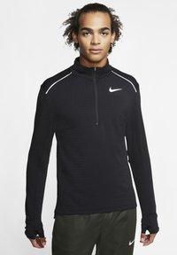 """Nike Performance - NIKE PERFORMANCE HERREN LAUFSHIRT """"THERMA SPHERE 3.0"""" LANGARM - Long sleeved top - black - 0"""