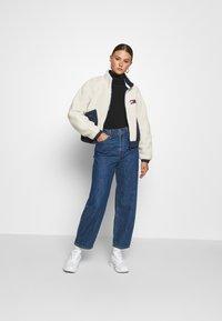 Tommy Jeans - REVERSIBLE JACKET - Winter jacket - twilight navy/white - 1