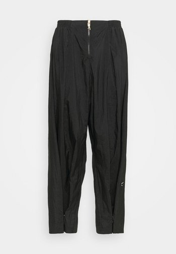 PANT IN - Tracksuit bottoms - black