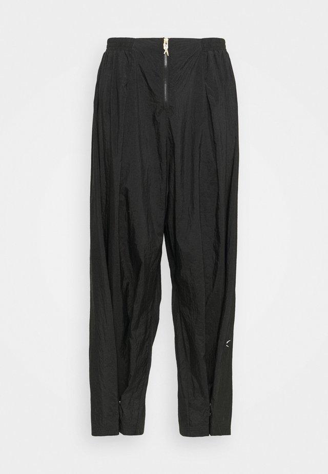 PANT IN - Pantaloni sportivi - black