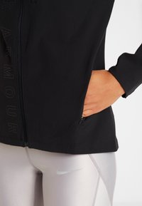 Under Armour - OUTRUN THE STORM  - Sports jacket - black - 3