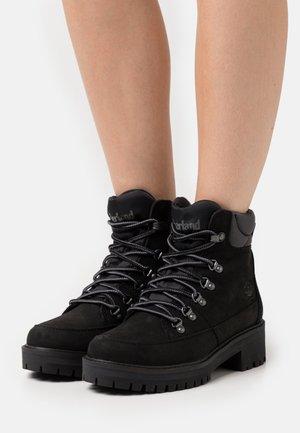 COURMAYEUR HIKER WP - Lace-up ankle boots - black