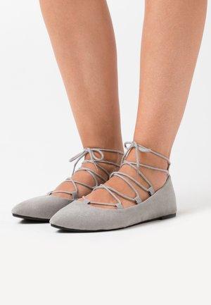 ANYTA - Ankle strap ballet pumps - grey