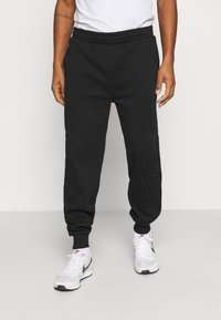 Lacoste LIVE - Tracksuit bottoms - black - 0