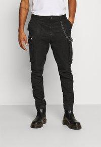 Tigha - ENRIQUE - Leather trousers - black - 0