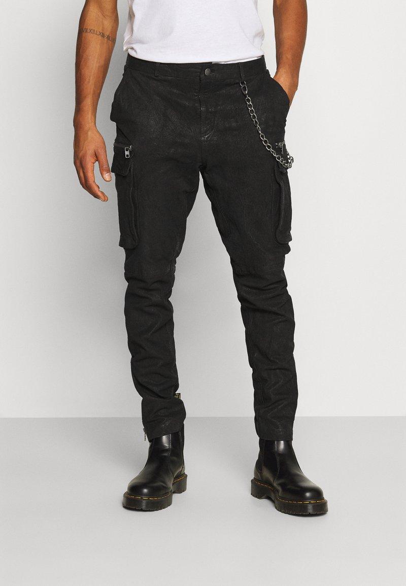 Tigha - ENRIQUE - Leather trousers - black