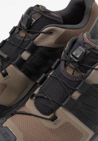 Salomon - XA WILD - Trail running shoes - bungee cord/phantom/burnt brick - 5