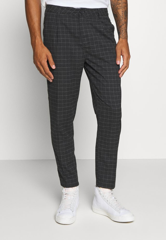 OXFORD - Trousers - black/off-white