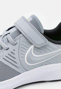 Nike Performance - STAR RUNNER 2 UNISEX - Neutral running shoes - wolf grey/white/black/volt - 5